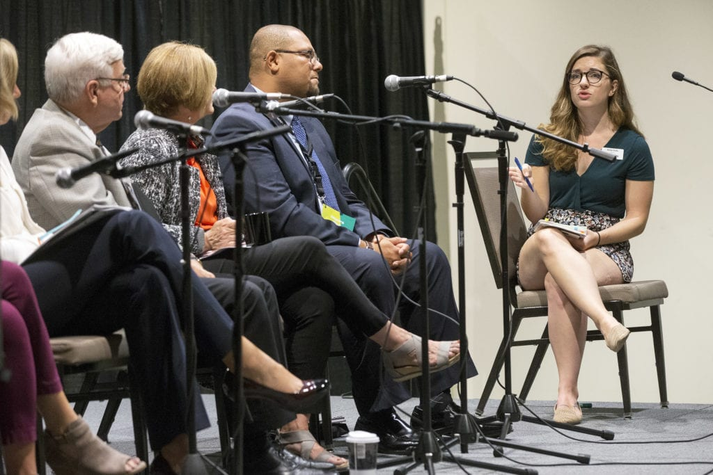 Gazette reporter Molly Duffy moderates a panel in the Human Social Services track, Protecting Iowa's Kids, at the second annual Iowa Ideas conference at the DoubleTree by Hilton Hotel Cedar Rapids Convention Complex on Thursday, Sept. 20, 2018. (Liz Martin/The Gazette)