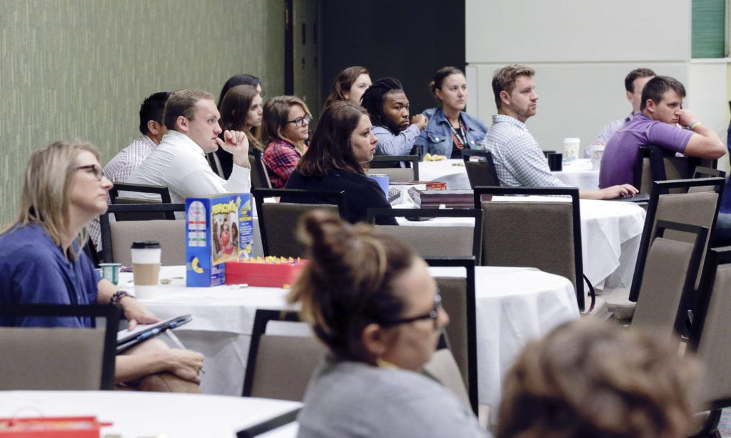 Audience members listen as Zachary Mannheimer principal community placemaker with McClure Engineering talks about his theory that small communities in are prime spots for new business and young professionals to thrive in his Next Gen Summit Saving Rural Iowa keynote address during the Iowa Ideas 2018 Conference at the DoubleTree by Hilton Hotel Cedar Rapids Convention Complex in northeast Cedar Rapids, Iowa on Friday, Sept. 21, 2018. (Jim Slosiarek/The Gazette)